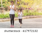 mother and her daughter running ... | Shutterstock . vector #617972132