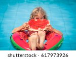 child eating watermelon outdoor.... | Shutterstock . vector #617973926