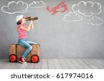 child pretend to be pilot. kid... | Shutterstock . vector #617974016
