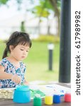 little asian girl painting at... | Shutterstock . vector #617989982