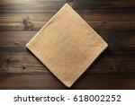 hessian burlap napkin on wooden ... | Shutterstock . vector #618002252
