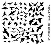 set of silhouettes of birds.... | Shutterstock .eps vector #618019382