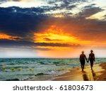 Lovers Walk Along The Beach At...