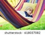 child sleep in hammock. | Shutterstock . vector #618037082