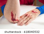a man's red  bloody  and... | Shutterstock . vector #618040532