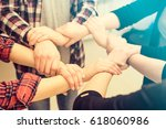 a group of young people hold... | Shutterstock . vector #618060986