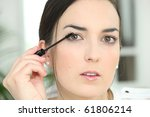 portrait of a woman making up... | Shutterstock . vector #61806214