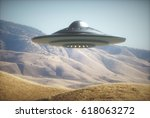 3D illustration with photography. Alien spaceship flying among the mountains.