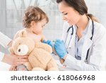young woman pediatrician... | Shutterstock . vector #618066968