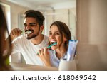 couple doing a morning hygiene... | Shutterstock . vector #618069542