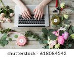 smiling mature woman florist... | Shutterstock . vector #618084542
