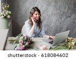 smiling mature woman florist... | Shutterstock . vector #618084602