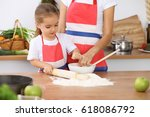 happy family in the kitchen.... | Shutterstock . vector #618086792