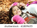 Happy family, mother and son, woman and child on autumn orange leaves. Outdoor. - stock photo