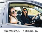 pose of two women smiling to... | Shutterstock . vector #618133316