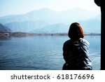 silhouette a lonely girl... | Shutterstock . vector #618176696