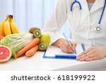 nutritionist doctor writing... | Shutterstock . vector #618199922