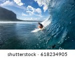 Muscular Surfer Riding On Big...