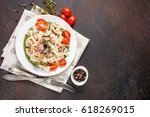 paste with tomatoes  seafood... | Shutterstock . vector #618269015