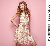 blonde young woman in floral... | Shutterstock . vector #618272702