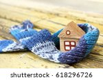 small wooden house in a warm... | Shutterstock . vector #618296726