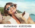 dog kisses his owner | Shutterstock . vector #618332486
