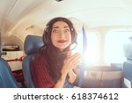Small photo of Fear of flying woman in plane . Person in airplane with aerophobia scared of flying being afraid while sitting in airplane seat. Funny girl portrain on fish eye lense