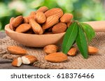 heap of peeled almonds with... | Shutterstock . vector #618376466