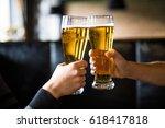 men cheers with beer in glasses ...   Shutterstock . vector #618417818