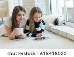 girls with a tablet  | Shutterstock . vector #618418022