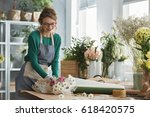young smiling florist working... | Shutterstock . vector #618420575