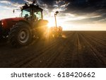farmer with tractor seeding  ... | Shutterstock . vector #618420662