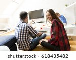 young people sit in a room and... | Shutterstock . vector #618435482
