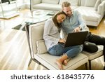 young couple sitting on a sofa  ... | Shutterstock . vector #618435776