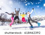 group of friends with ski on... | Shutterstock . vector #618462392