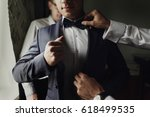 stylish groomsmen helping happy ... | Shutterstock . vector #618499535