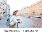 beautiful girl in a hat smiling ... | Shutterstock . vector #618565172