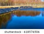 Small photo of Leachate pond with synthetic lining and surrounding fence. Location Ronneby, Sweden.