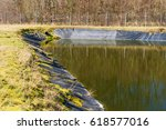 Small photo of Landfill leachate pouring into pond from a black pipe. Location Ronneby, Sweden.