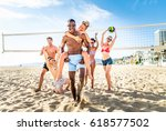 group of friends playing beach... | Shutterstock . vector #618577502