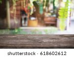 empty wooden table in front of...   Shutterstock . vector #618602612