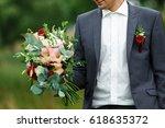 groom holding in hands delicate ... | Shutterstock . vector #618635372