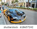 Small photo of LOS ANGELES, USA - APRIL 5, 2014: People walk by Bugatti Veyron supercar parked in Beverly Hills, Los Angeles. Beverly Hills is a district of upscale shopping and rich celebrities.