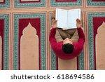 religious muslim man praying... | Shutterstock . vector #618694586