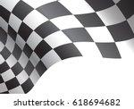 Checkered Flag Flying On White...