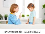 mother scolds and punishes the... | Shutterstock . vector #618695612