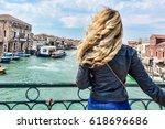 woman walking in murano island... | Shutterstock . vector #618696686
