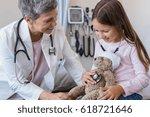 happy little girl checking... | Shutterstock . vector #618721646
