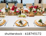 decorated plates on the banquet ... | Shutterstock . vector #618745172