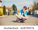 mischievous boy with broken... | Shutterstock . vector #618749276